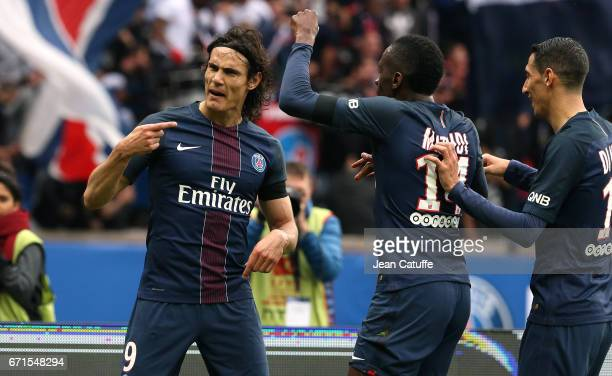 Edinson Cavani of PSG celebrates his goal with Blaise Matuidi Angel di Maria during the French Ligue 1 match between Paris SaintGermain and...
