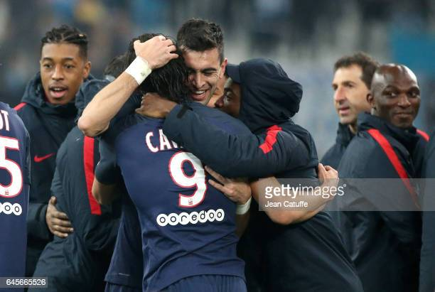 Edinson Cavani of PSG celebrates his goal with Javier Pastore Serge Aurier Presnel Kimpembe assistantcoach of PSG Zoumana Camara during the French...
