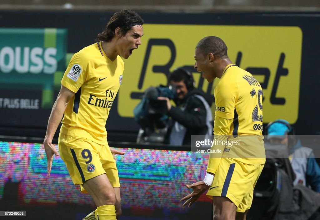 Edinson Cavani of PSG celebrates his goal with Kylian Mbappe during the French Ligue 1 match between Angers SCO and Paris Saint Germain (PSG) at Stade Raymond Kopa on November 4, 2017 in Angers, France.