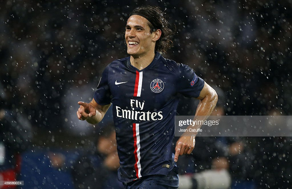 Edinson Cavani of PSG celebrates his second goal during the UEFA Champions League Group F match between Paris Saint-Germain FC and Ajax Amsterdam at Parc des Princes stadium on November 25, 2014 in Paris, France.