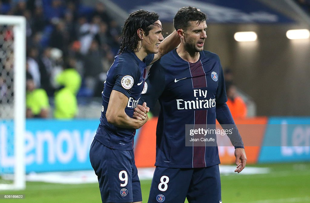 Edinson Cavani of PSG celebrates his second goal with Thiago Motta during the French Ligue 1 match between Olympique Lyonnais (OL) and Paris Saint-Germain (PSG) at Parc OL stadium on November 27, 2016 in Decines near Lyon, France.