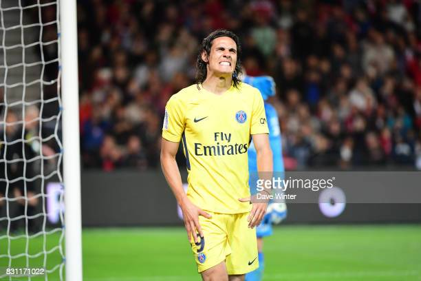 Edinson Cavani of PSG grimaces as he is injured at the end of the Ligue 1 match between EA Guingamp and Paris Saint Germain at Stade du Roudourou on...