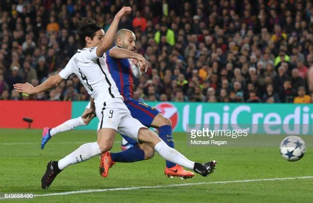 Edinson Cavani of PSG holds off Javier Mascherano of Barcelona to shoot against the post during the UEFA Champions League Round of 16 second leg...
