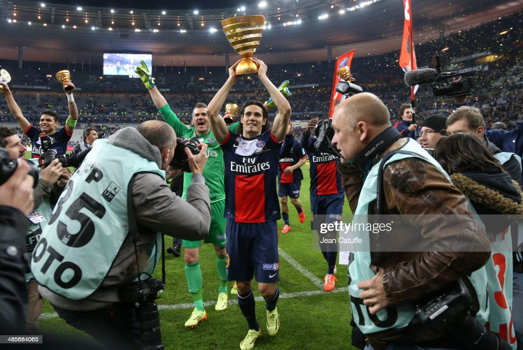 <a gi-track='captionPersonalityLinkClicked' href=/galleries/search?phrase=Edinson+Cavani&family=editorial&specificpeople=4104253 ng-click='$event.stopPropagation()'>Edinson Cavani</a> of PSG holds the trophy and celebrates the victory at the end of the French League Cup Final (finale de la Coupe de la Ligue) between Olympique Lyonnais OL and Paris Saint-Germain FC at Stade de France on April 19, 2014 in Saint Denis near Paris, France.
