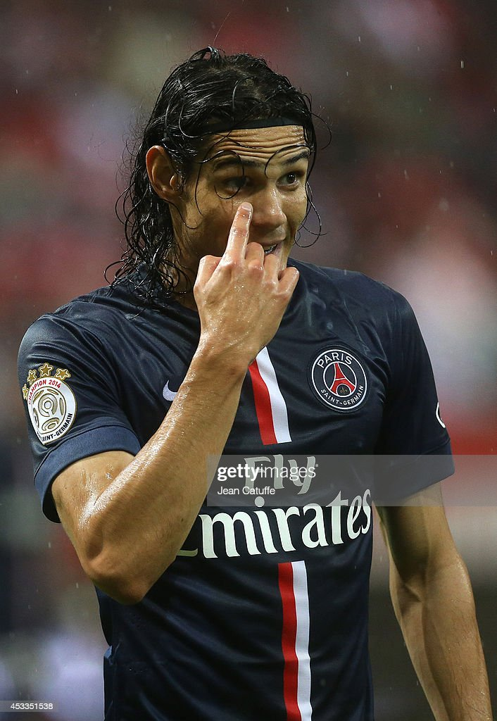 <a gi-track='captionPersonalityLinkClicked' href=/galleries/search?phrase=Edinson+Cavani&family=editorial&specificpeople=4104253 ng-click='$event.stopPropagation()'>Edinson Cavani</a> of PSG in action during the French Ligue 1 match between Stade de Reims and Paris Saint Germain FC at the Stade Auguste Delaune on August 8, 2014 in Reims, France.