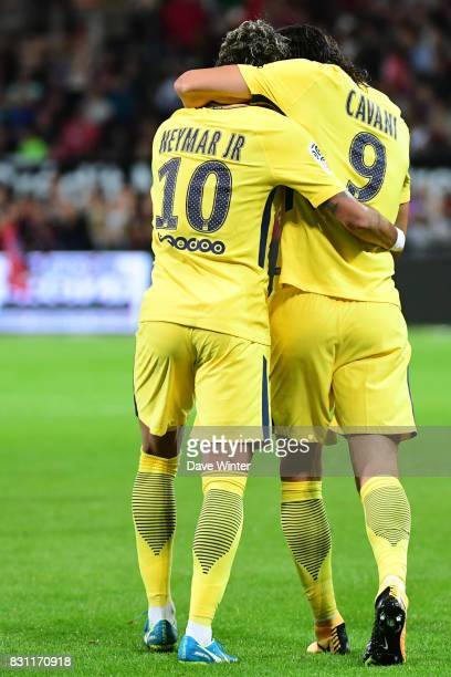 Edinson Cavani of PSG is congratulated on his goal by Neymar JR of PSG during the Ligue 1 match between EA Guingamp and Paris Saint Germain at Stade...