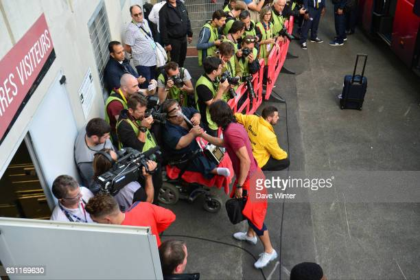 Edinson Cavani of PSG is greeted by a disabled supporter as he arrives for the Ligue 1 match between EA Guingamp and Paris Saint Germain at Stade du...
