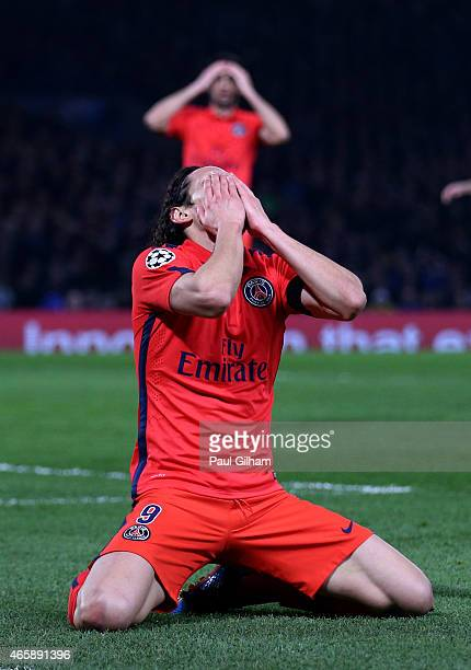 Edinson Cavani of PSG reacts after a missed chance on goal during the UEFA Champions League Round of 16 second leg match between Chelsea and Paris...