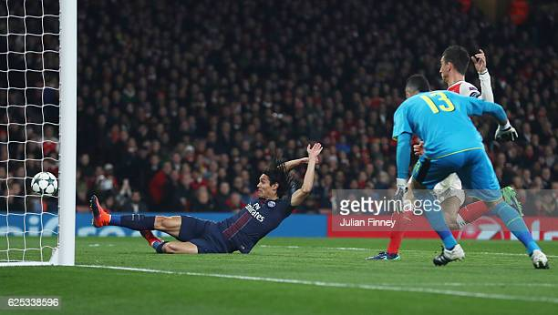 Edinson Cavani of PSG scores his sides first goal during the UEFA Champions League Group A match between Arsenal FC and Paris SaintGermain at the...