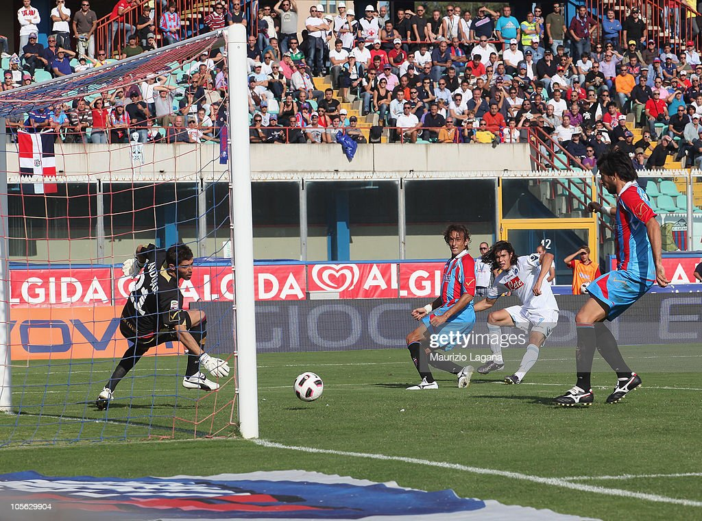 Edinson Cavani of SSC Napoli scores his team's opening goal during the Serie A match between Catania Calcio and SSC Napoli at Stadio Angelo Massimino...