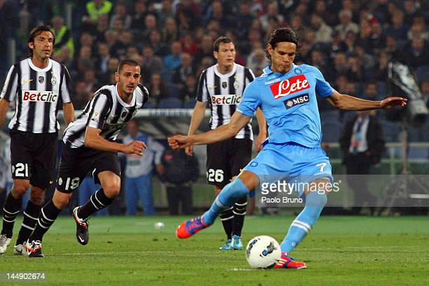 Edinson Cavani of SSC Napoli scores the opening goal by the penalty during the Tim Cup final match between Juventus FC and SSC Napoli at Olimpico...