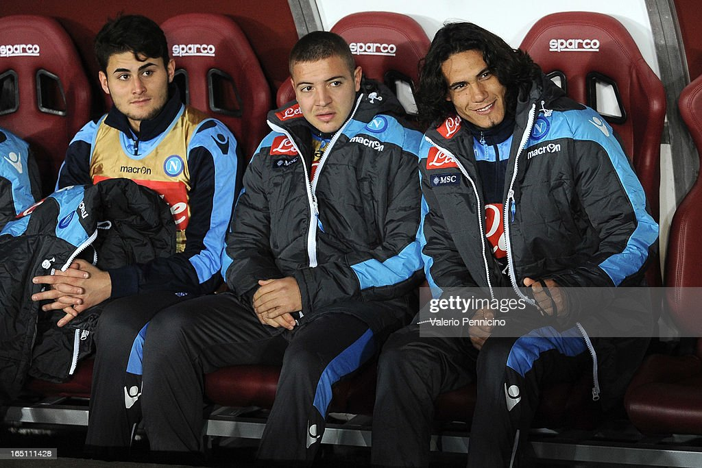 <a gi-track='captionPersonalityLinkClicked' href=/galleries/search?phrase=Edinson+Cavani&family=editorial&specificpeople=4104253 ng-click='$event.stopPropagation()'>Edinson Cavani</a> (R) of SSC Napoli sits on the bench prior to the Serie A match between Torino FC and SSC Napoli at Stadio Olimpico di Torino on March 30, 2013 in Turin, Italy.