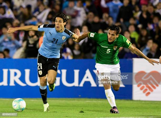 Edinson Cavani of Uruguay and Gabriel Valverde of Bolivia fight for the ball during a match between Uruguay and Bolivia as part of FIFA 2018 World...