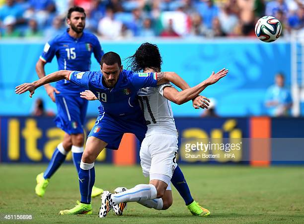 Edinson Cavani of Uruguay and Leonardo Bonucci of Italy compete for teh ball during the 2014 FIFA World Cup Brazil Group D match between Italy and...