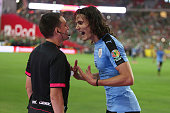 Edinson Cavani of Uruguay argues with assistant referee Milciades Saldivar during the second half of a group C match between Mexico and Uruguay at...