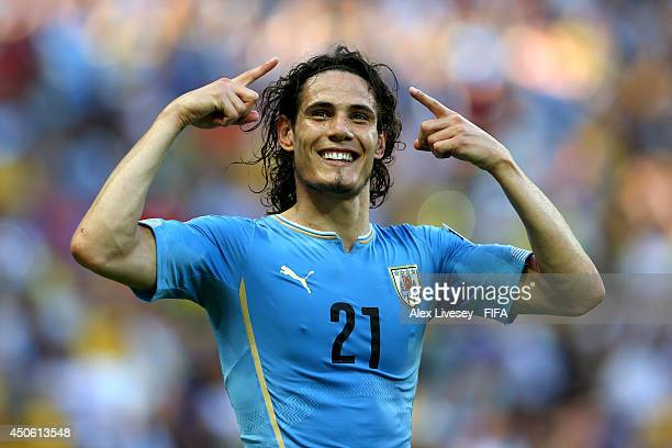 Edinson Cavani of Uruguay celebrates after scoring from the penalty spot during the 2014 FIFA World Cup Brazil Group D match between Uruguay and...
