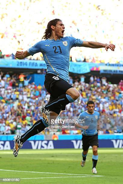 Edinson Cavani of Uruguay celebrates scoring his team's first goal on a penalty kick during the 2014 FIFA World Cup Brazil Group D match between...