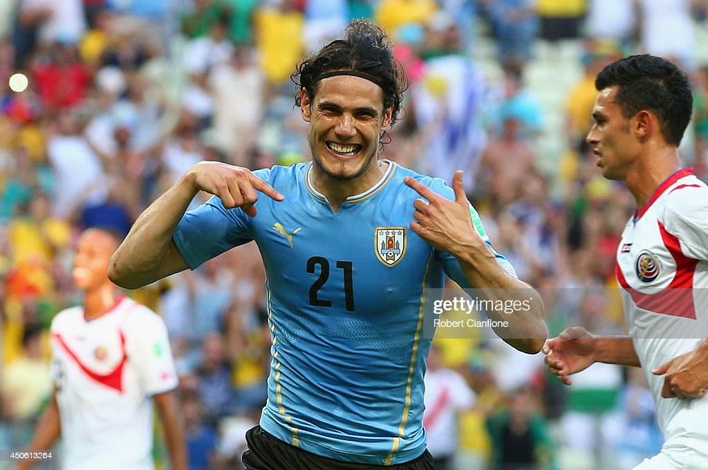 Edinson Cavani of Uruguay celebrates scoring his team's first goal on a penalty kick during the 2014 FIFA World Cup Brazil Group D match between Uruguay and Costa Rica at Castelao on June 14, 2014 in Fortaleza, Brazil.