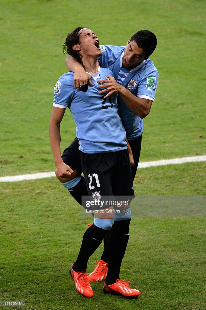 Edinson Cavani of Uruguay celebrates scoring his team's first goal to make the score 1-1 with team-mate Luis Suarez (R) during the FIFA Confederations Cup Brazil 2013 Semi Final match between Brazil and Uruguay at Governador Magalhaes Pinto Estadio Mineirao on June 26, 2013 in Belo Horizonte, Brazil.