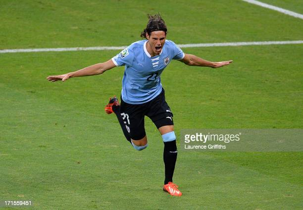 Edinson Cavani of Uruguay celebrates scoring his team's first goal to make the score 11 during the FIFA Confederations Cup Brazil 2013 Semi Final...