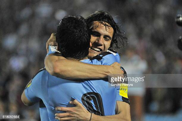 Edinson Cavani of Uruguay celebrates with teammate Luis Suarez after scoring the only goal during a match between Uruguay and Peru as part of FIFA...