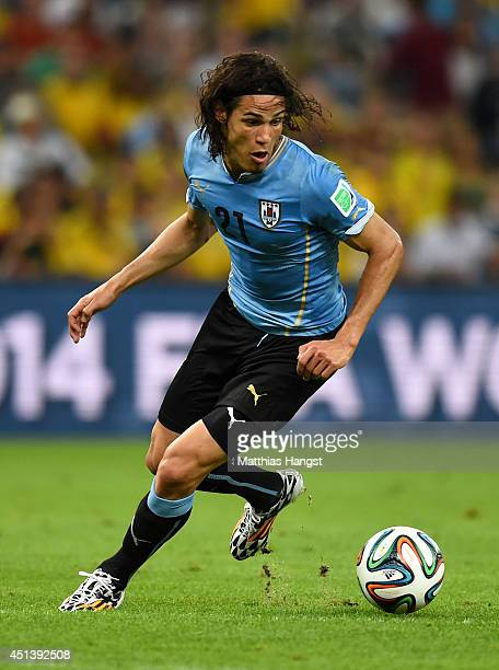 Edinson Cavani of Uruguay controls the ball during the 2014 FIFA World Cup Brazil round of 16 match between Colombia and Uruguay at Maracana on June...