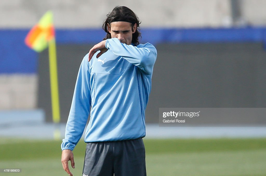 <a gi-track='captionPersonalityLinkClicked' href=/galleries/search?phrase=Edinson+Cavani&family=editorial&specificpeople=4104253 ng-click='$event.stopPropagation()'>Edinson Cavani</a> of Uruguay gestures during a training session at Nacional Stadium on June 23, 2015 in Santiago, Chile. Uruguay will face Chile as part of 2015 Copa America Chile on June 24.