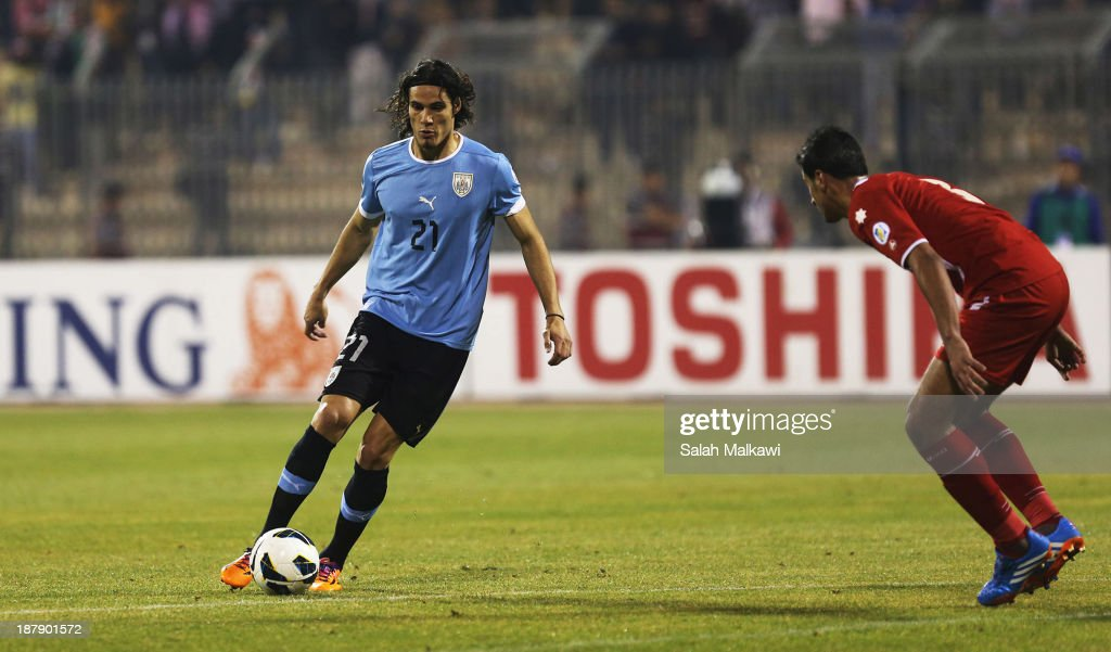 <a gi-track='captionPersonalityLinkClicked' href=/galleries/search?phrase=Edinson+Cavani&family=editorial&specificpeople=4104253 ng-click='$event.stopPropagation()'>Edinson Cavani</a> of Uruguay in action during the FIFA 2014 World Cup Qualifier: Intercontinental Play-off First Leg between Jordan and Uruguay on November 13, 2013 in Amman, Jordan.