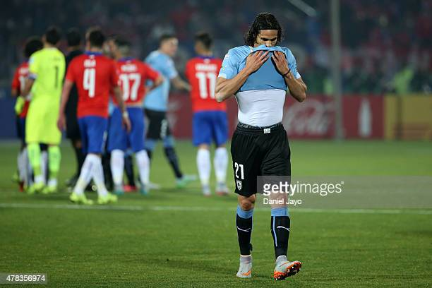 Edinson Cavani of Uruguay leaves the field after being sent off during the 2015 Copa America Chile quarter final match between Chile and Uruguay at...