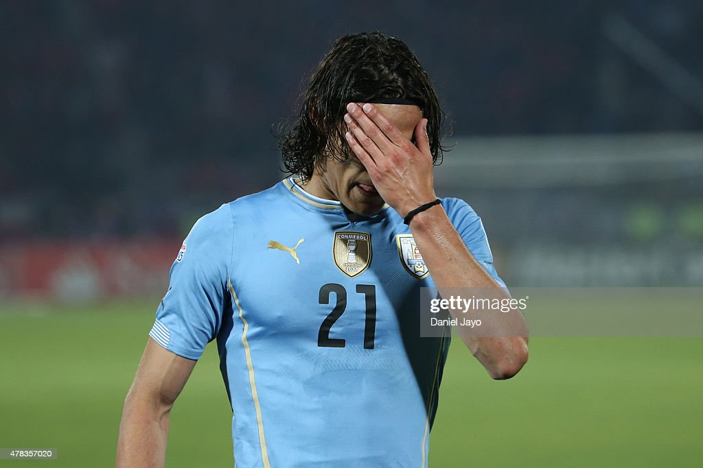 Edinson Cavani of Uruguay looks dejected after being sent off during the 2015 Copa America Chile quarter final match between Chile and Uruguay at Nacional Stadium on June 24, 2015 in Santiago, Chile.