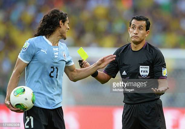 Edinson Cavani of Uruguay reacts to Referee Enrique Osses of Chile during the FIFA Confederations Cup Brazil 2013 Semi Final match between Brazil and...