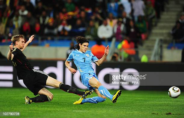 Edinson Cavani of Uruguay scores his side's first goal during the 2010 FIFA World Cup South Africa Third Place Playoff match between Uruguay and...