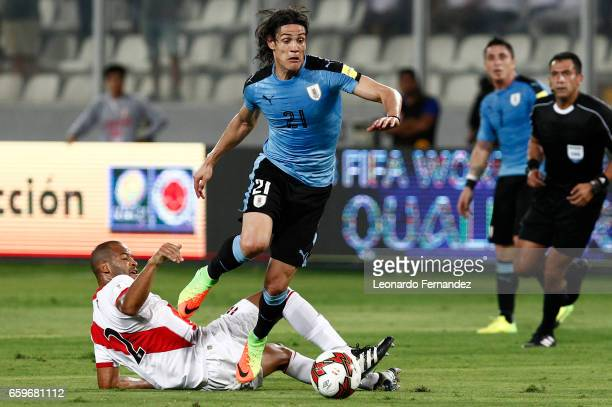 Edinson Cavani of Uruguay struggles for the ball with Alberto Rodriguez of Peru during a match between Peru and Uruguay as part of FIFA 2018 World...