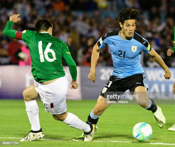 Edinson Cavani of Uruguay tries to dribble Ronald Raldes of Bolivia during a match between Uruguay and Bolivia as part of FIFA 2018 World Cup...