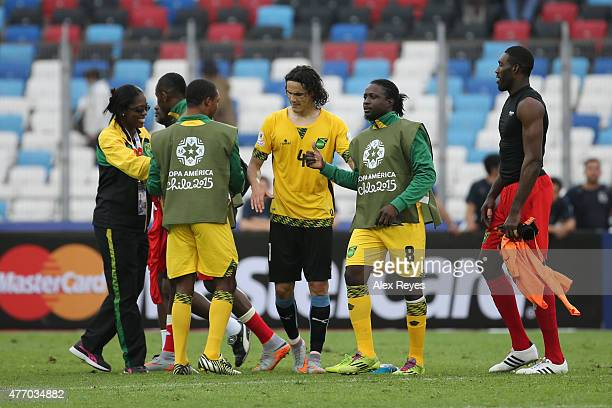 Edinson Cavani of Uruguay wearing the jersey of Wes Morgan of Jamaica greets Jamaican players after the 2015 Copa America Chile Group B match between...