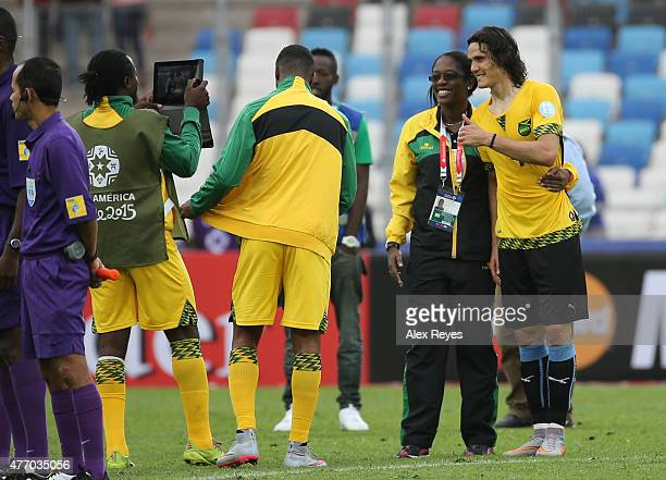 Edinson Cavani of Uruguay wearing the jersey of Wes Morgan of Jamaica poses for photos after the 2015 Copa America Chile Group B match between...