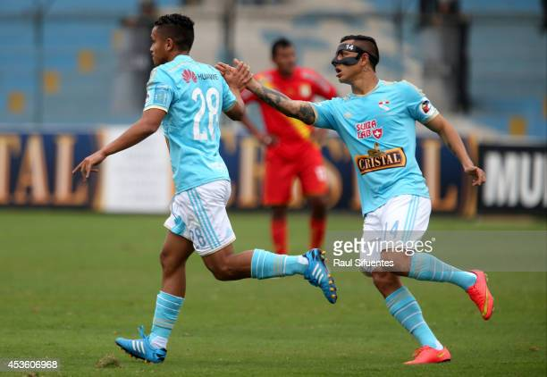 Edinson Chavez of Sporting Cristal celebrates with teammates after scoring the opening goal against Sport Huancayo during a match between Sporting...