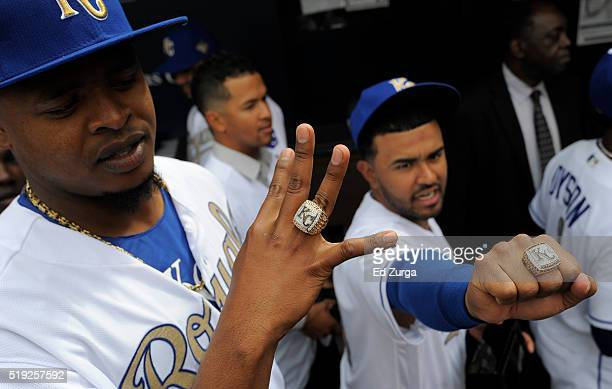 Edinson Volquez and Christian Colon of the Kansas City Royals show off their World Series Championship rings before a game against the New York Mets...