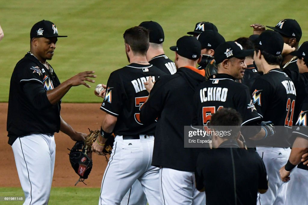 Edinson Volquez #36 of the Miami Marlins gets the baseball from Justin Bour #41after throwing a no hitter against the Arizona Diamondbacks at Marlins Park on June 3, 2017 in Miami, Florida.