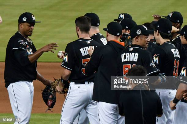 Edinson Volquez of the Miami Marlins gets the baseball from Justin Bour throwing a no hitter against the Arizona Diamondbacks at Marlins Park on June...