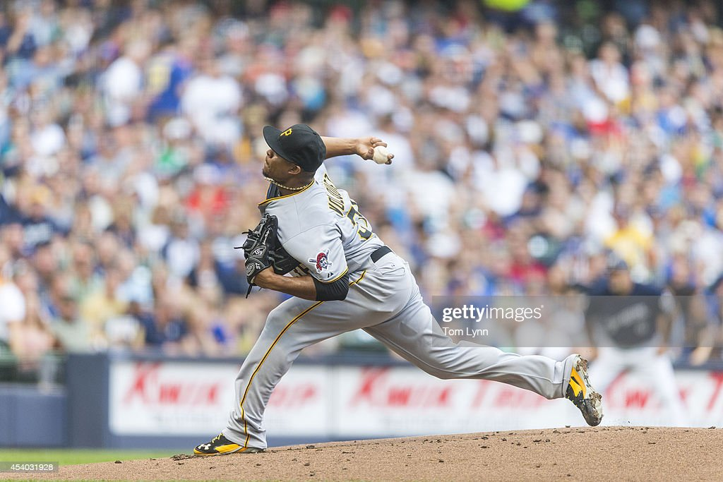 Edinson Volquez #36 of the Pittsburg Pirates pitches to a Milwaukee Brewers batter at Miller Park on August 23, 2014 in Milwaukee, Wisconsin.