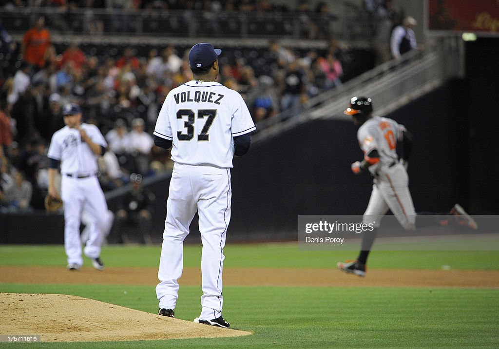 <a gi-track='captionPersonalityLinkClicked' href=/galleries/search?phrase=Edinson+Volquez&family=editorial&specificpeople=3851791 ng-click='$event.stopPropagation()'>Edinson Volquez</a> #37 of the San Diego Padres stands next to the mound as Adam Jones #10 of the Baltimore Orioles rounds the bases after he hit a solo home run during the fourth inning of a baseball game at Petco Park on August 6, 2013 in San Diego, California.
