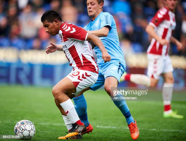 Edison Flores of AaB Aalborg and Joel Allansson of Randers FC compete for the ball during the Danish Alka Superliga match between Randers FC and AaB...
