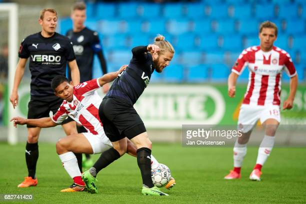 Edison Flores of AaB Aalborg and Kasper Fisker of Randers FC compete for the ball during the Danish Alka Superliga match between AaB Aalborg and...