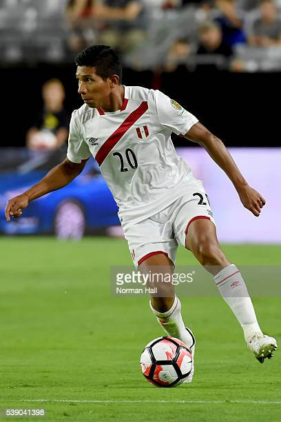 Edison Flores of Peru brings the ball up field during a group B match between Ecuador and Peru at University of Phoenix Stadium as part of Copa...