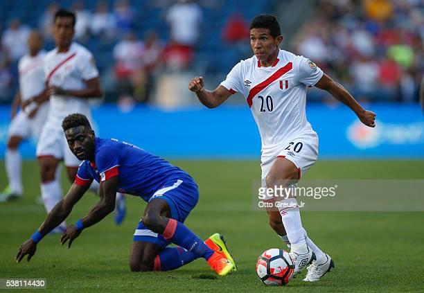 Edison Flores of Peru dribbles against Reginal Goreux of Haiti during the Copa America Centenario Group B match at CenturyLink Field on June 4 2016...