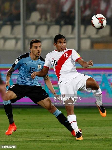 Edison Flores of Peru fights for the ball with Matias Vecino of Uruguay during a match between Peru and Uruguay as part of FIFA 2018 World Cup at...