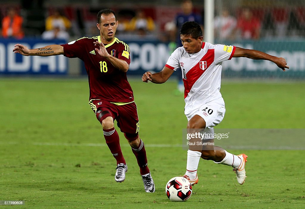 <a gi-track='captionPersonalityLinkClicked' href=/galleries/search?phrase=Edison+Flores&family=editorial&specificpeople=8597891 ng-click='$event.stopPropagation()'>Edison Flores</a> (R) of Peru struggles for the ball with Alejandro Guerra (L) of Venezuela during a match between Peru and Venezuela as part of FIFA 2018 World Cup Qualifiers at Nacional Stadium on March 24, 2016 in Lima, Peru.