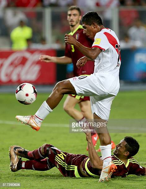 Edison Flores of Peru struggles for the ball with Angel Faria of Venezuela during a match between Peru and Venezuela as part of FIFA 2018 World Cup...