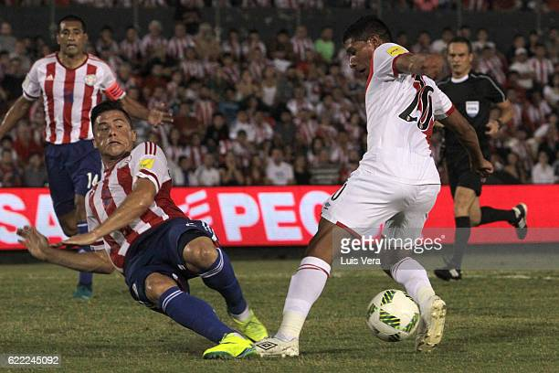 Edison Flores of Peru tries to avoid the slide by Jorge Moreira of Paraguay during a match between Paraguay and Peru as part of FIFA 2018 World Cup...